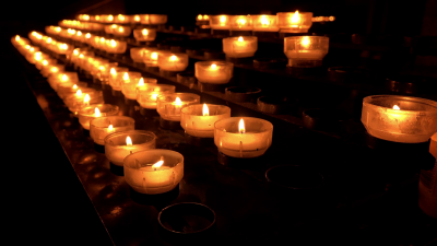burning-candles-in-church-as-a-memorial-4k_nkjgfwa8__F0000